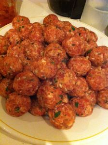 Large marble sized meatballs rolled and ready to go