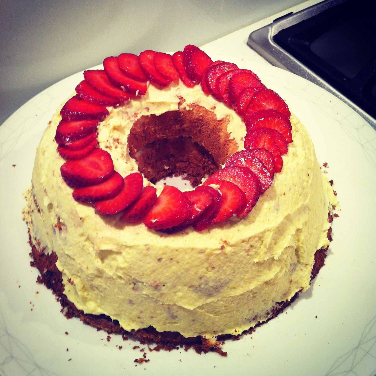 Angel food cake with a vanilla pudding and strawberry filling!